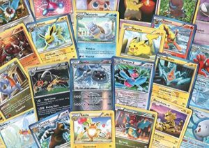 100 Assorted Pokemon Cards with Foils & Bonus Mew Promo! [Toy] de la marque Pokémon image 0 produit